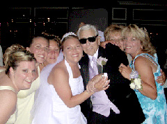 Bride with grandfather and friends at DJ wedding