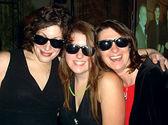 Having fun at corporate DJ party with party favor sunglasses
