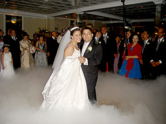 Bride and groom dancing on a cloud