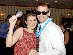 Couple dancing with party props at DJ wedding