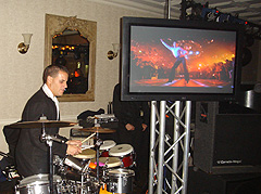"Percussionist  with 42"" plasma screen"
